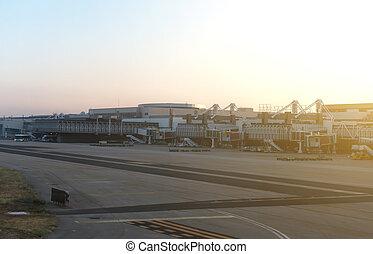Airport terminal docks at morning sunrise.