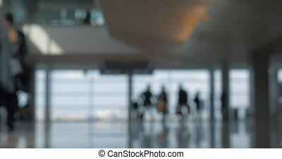 Airport terminal with walking people, defocus