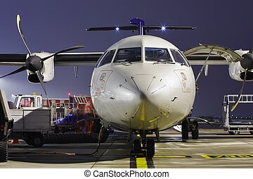 Airport - The ground crew is preparing the aircraft for take...