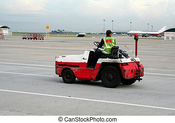 Airport vehicle - Airport worker on a vehicle, racing down...