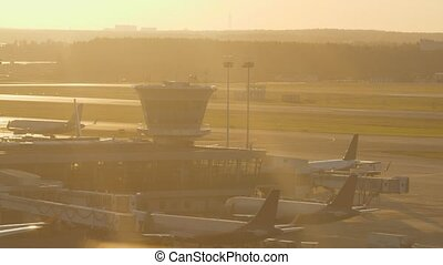 Airport view in warm light of sunset - Airport view with...