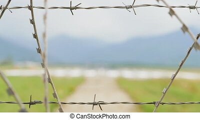 Airport view through the barbed wire fence in mountains - Georgia