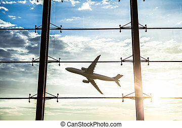 airport windows and airplane at sunset