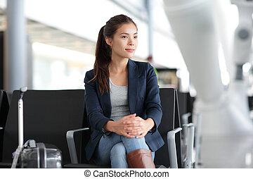 Airport woman waiting in terminal - air travel