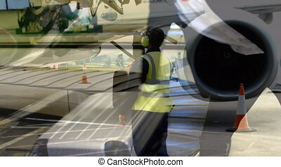 Animation of airplane over man picking up suitcase from conveyor belt in the airport. Global travel holiday business concept digitally generated image.