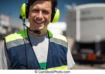 Airport worker smiling
