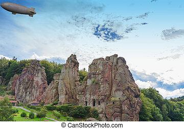 Airship, zeppelin flying over the Externsteine