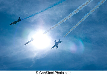 Airshow event - Three airplanes performing at an airshow