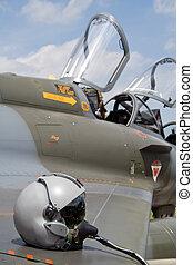 Airshow helmet - Pilot helmet on a military jet aircraft .