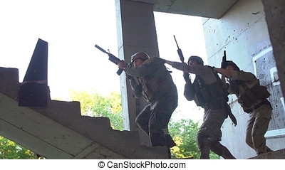 Airsoft Game. Men with guns playing airsoft.