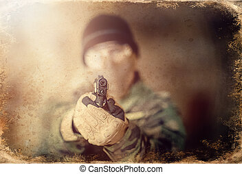 airsoft soldier with a rifle, old photo effect. - airsoft ...