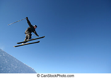 Airtime - A skier in a business-like pinstripe ski suit...