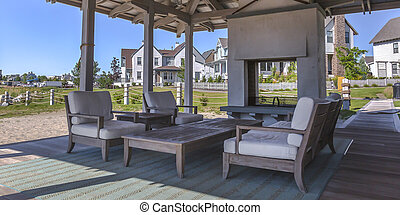 Airy patio with chairs and table on a sunny day