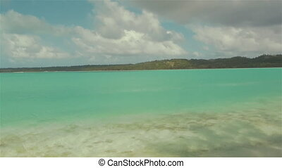 Aitutaki Lagoon In The Cook Islands Polynesia South Pacific Ocean. Tropical Beach Reef Panoramic With Coconut Palm Trees Swaying In Windy Cloudy Sky Over Blue Lagoon & White Sand & Sea