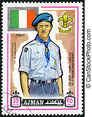 AJMAN - CIRCA 1971: A stamp printed in Ajman shows Scout and flag of Italy, 13th World Boy Scout Jamboree in Japan, circa 1971