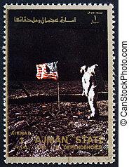 AJMAN - CIRCA 1973: a stamp printed in the Ajman shows Edwin...