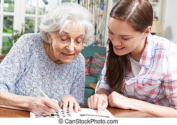 ajudando, adolescente, quebra-cabeça, neta, vó, crossword