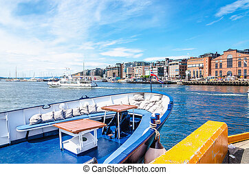 Aker Brygge from ship docked in port Oslo, Norway