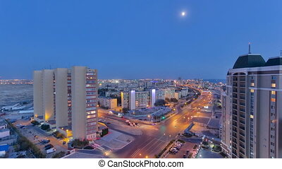 Aktau city after sunset on the shore of the Caspian Sea day to night timelapse. Kazakhstan.