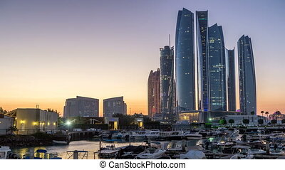 Al Bateen marina Abu Dhabi day to night timelapse with modern skyscrapers on background