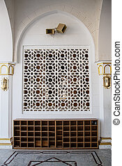 A window in the traditional oriental style and shoe racks mosque Al Salam in Egypt
