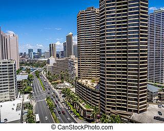 Ala Moana Boulevard in Waikiki facing in a northerly direction. Honolulu skyline visible.