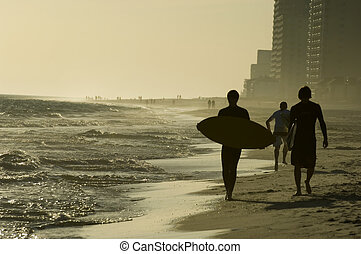 Alabama Gulf Shores - Teens with surfboards on the beach of...