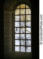 alabaster glass window in acient church (Germigny-des-Pres,...