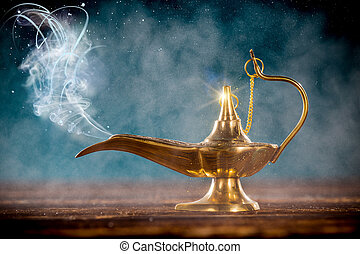 Aladdin magic lamp on wooden table with smoke.