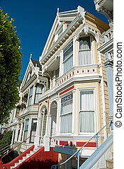 Alamo Square in San Francisco with Victorian houses -...