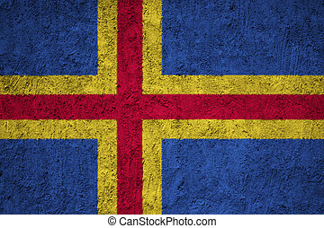 Aland flag painted on the cracked grunge concrete wall