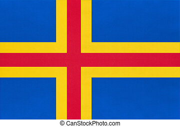 Aland Islands national fabric flag with emblem, textile background.
