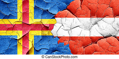 aland islands with Austria flag on a grunge cracked wall