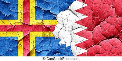 aland islands with Bahrain flag on a grunge cracked wall