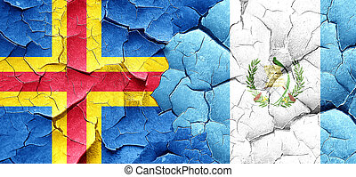 aland islands with Guatemala flag on a grunge cracked wall