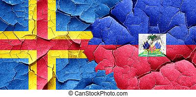 aland islands with Haiti flag on a grunge cracked wall