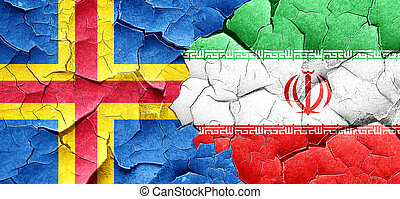 aland islands with Iran flag on a grunge cracked wall