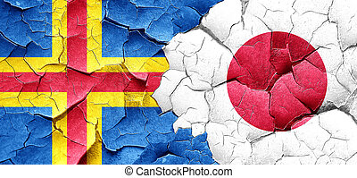 aland islands with Japan flag on a grunge cracked wall