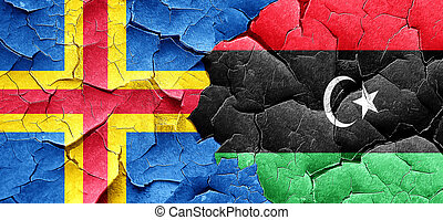 aland islands with Libya flag on a grunge cracked wall