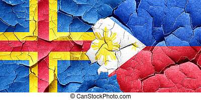 aland islands with Philippines flag on a grunge cracked wall