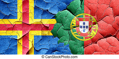 aland islands with Portugal flag on a grunge cracked wall