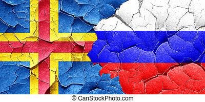 aland islands with Russia flag on a grunge cracked wall
