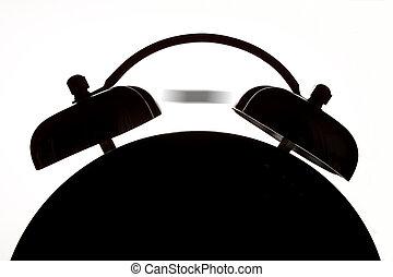 Alarm Clock - Abstract ringing alarm clock in silhouette...