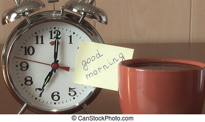 Alarm Clock - An alarm clock and a yellow note with this...