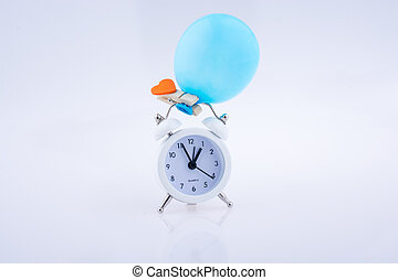 Alarm clock and a balloon with a heart