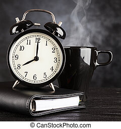 Alarm clock and a cup of coffee