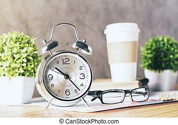 Alarm clock and glasses - Closeup of silver alarm clock, ...