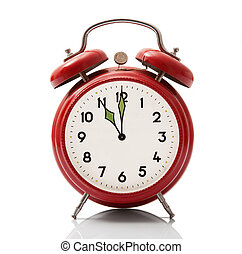 alarm clock at eleven hour on white background