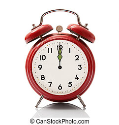 alarm clock at midnight hour on white background - isolated...