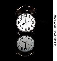 Alarm clock before black